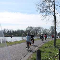 Fietstocht door Amsterdam olv een gids, met bezoek aan oude boerderij